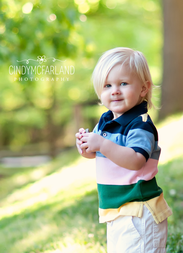 super cute 20 month old poses for outdoor photo