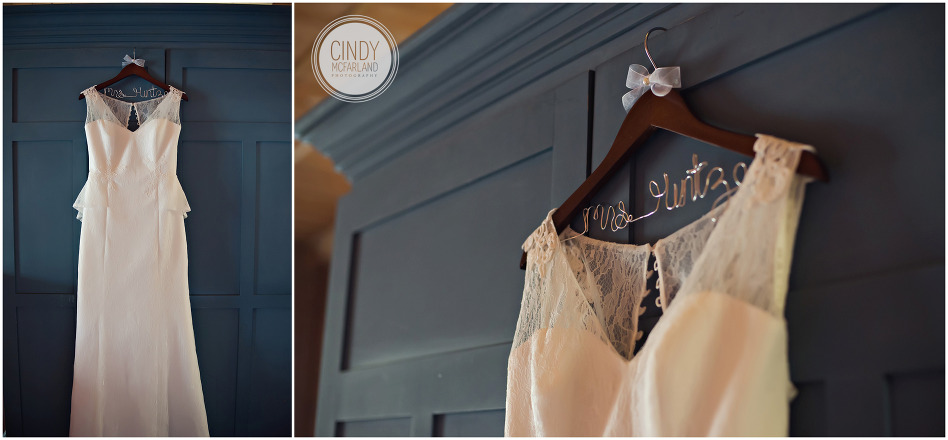 Detail photos of lacey, vintage wedding dress hanging on vintage blue armoire